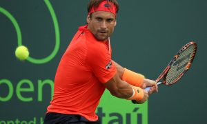 KEY BISCAYNE, FL - MARCH 28:  David Ferrer of Spain plays a match against Federico Delbonis of Argentina during Day 6 of the Miami Open presented by Itau at Crandon Park Tennis Center on March 28, 2015 in Key Biscayne, Florida.  (Photo by Mike Ehrmann/Getty Images)